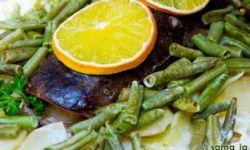 Сом с овощами под апельсином